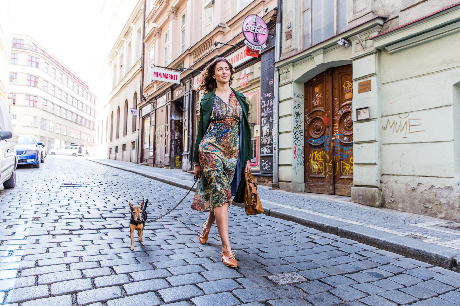 Woman Walking Down Cobble Streets with Dog
