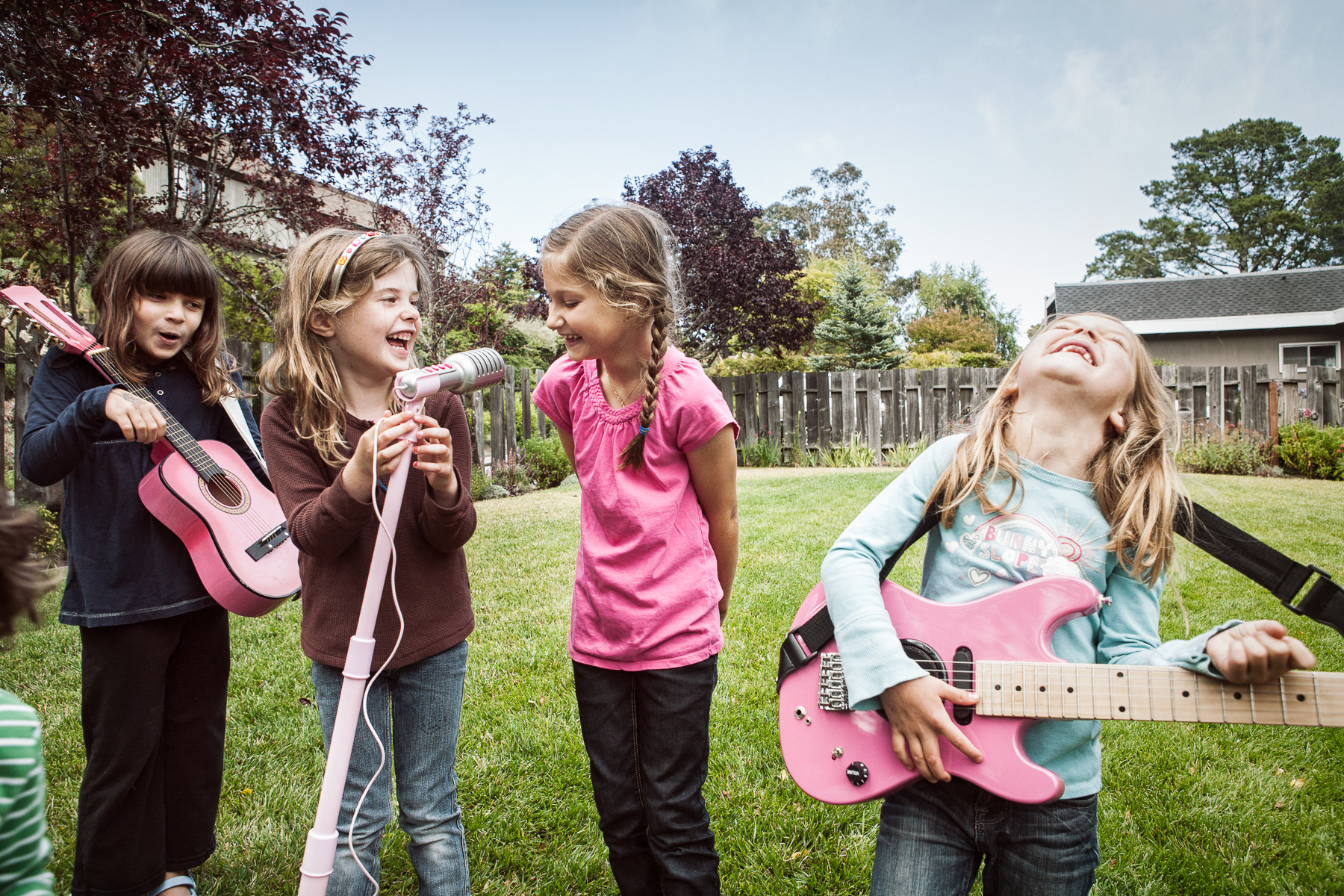 Girls Playing Instruments in a Backyard