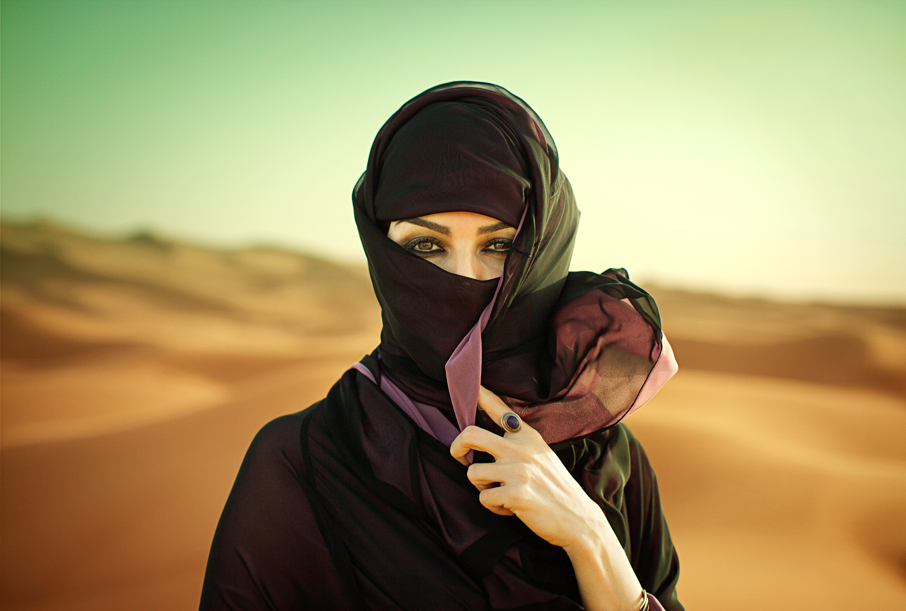Woman in the Desert in a Hijab