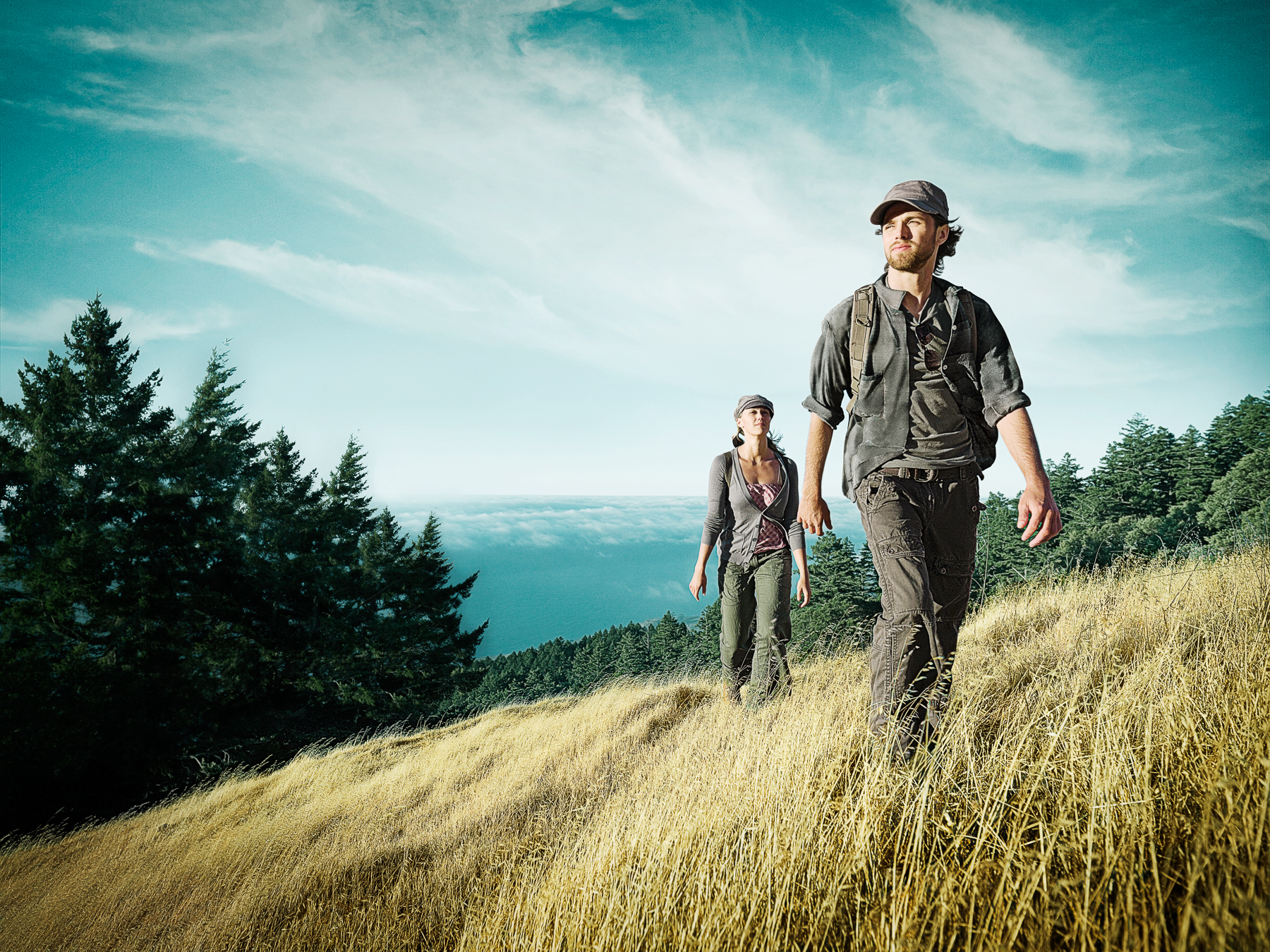 Two Hikers on a Yellow Hill