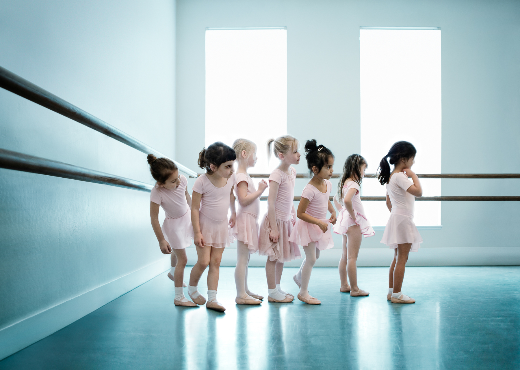 Young Ballerinas waiting for their Turn in a Dance Studio