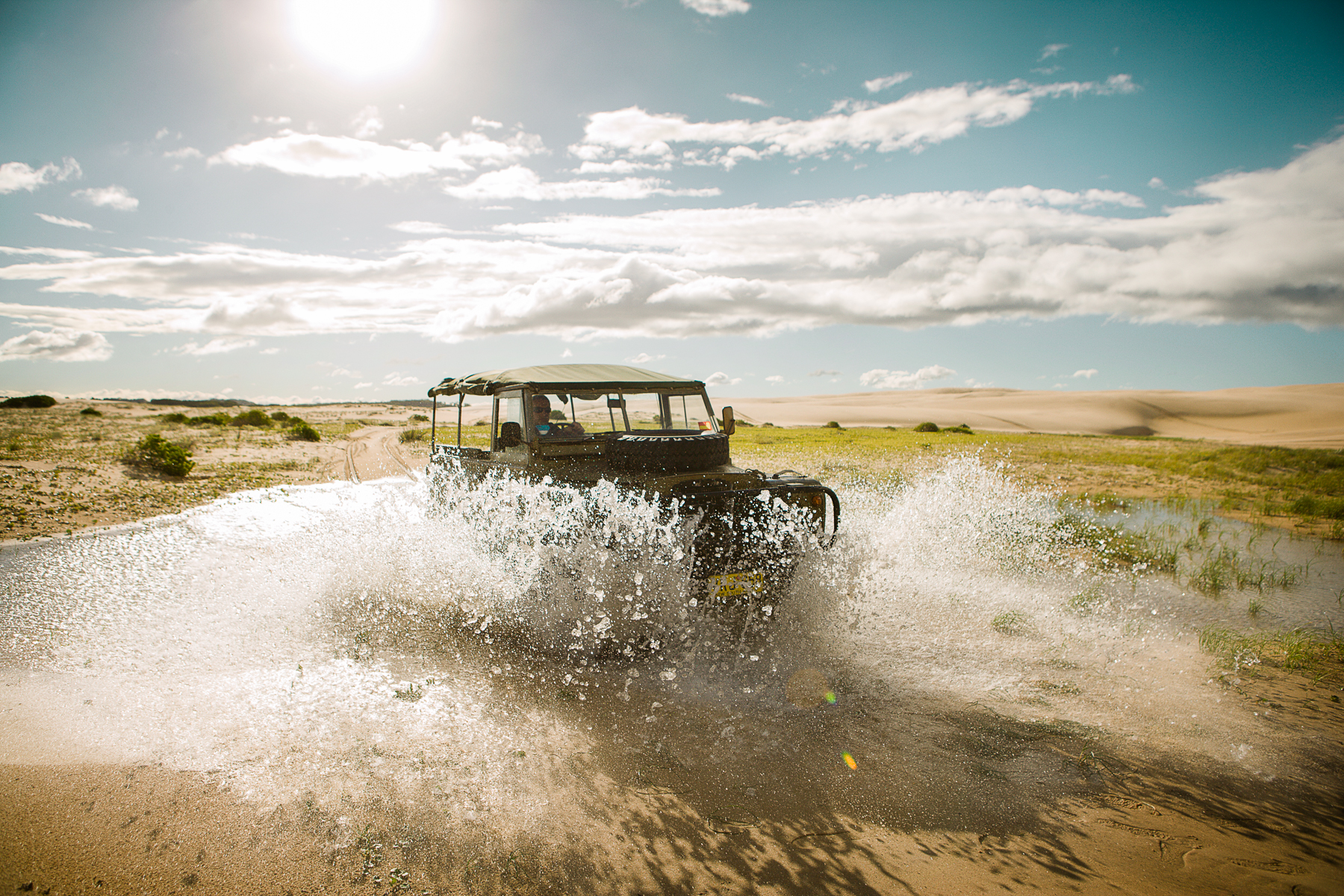Safari Car Driving through a Puddle