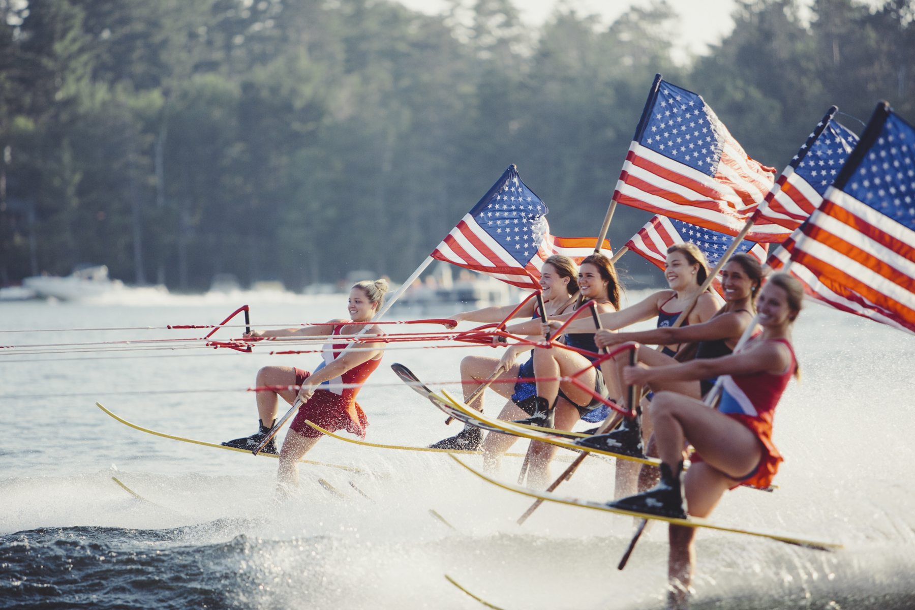 Young women Water Ski with American Flags