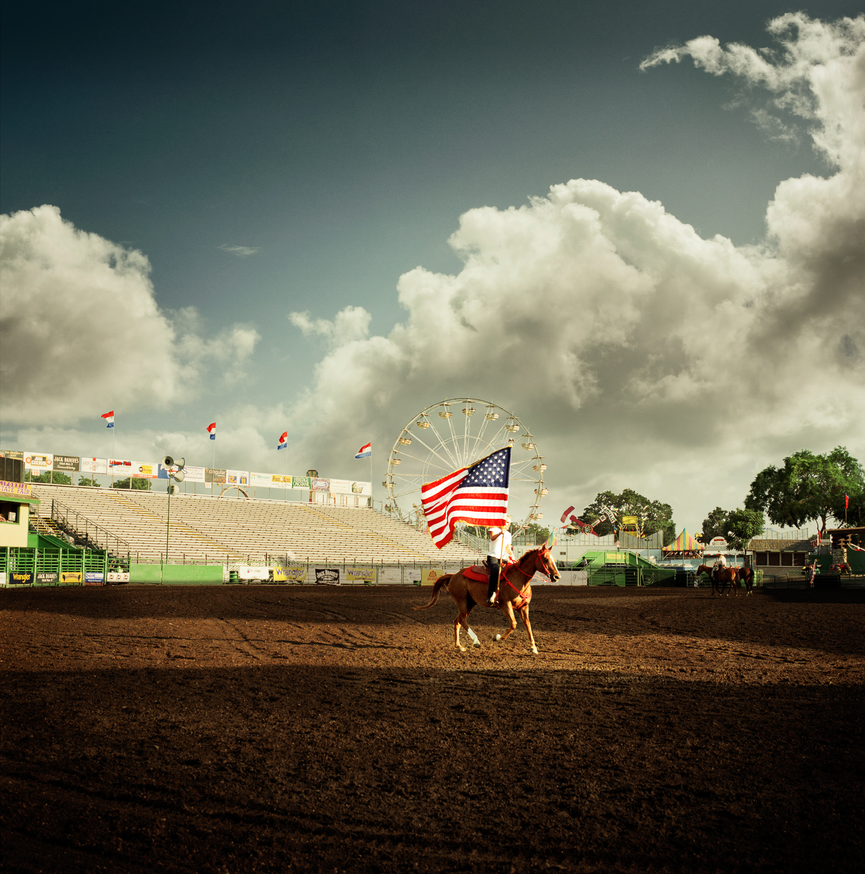 Road Trip - Man Riding a Horse Carrying a Flag at a Fair