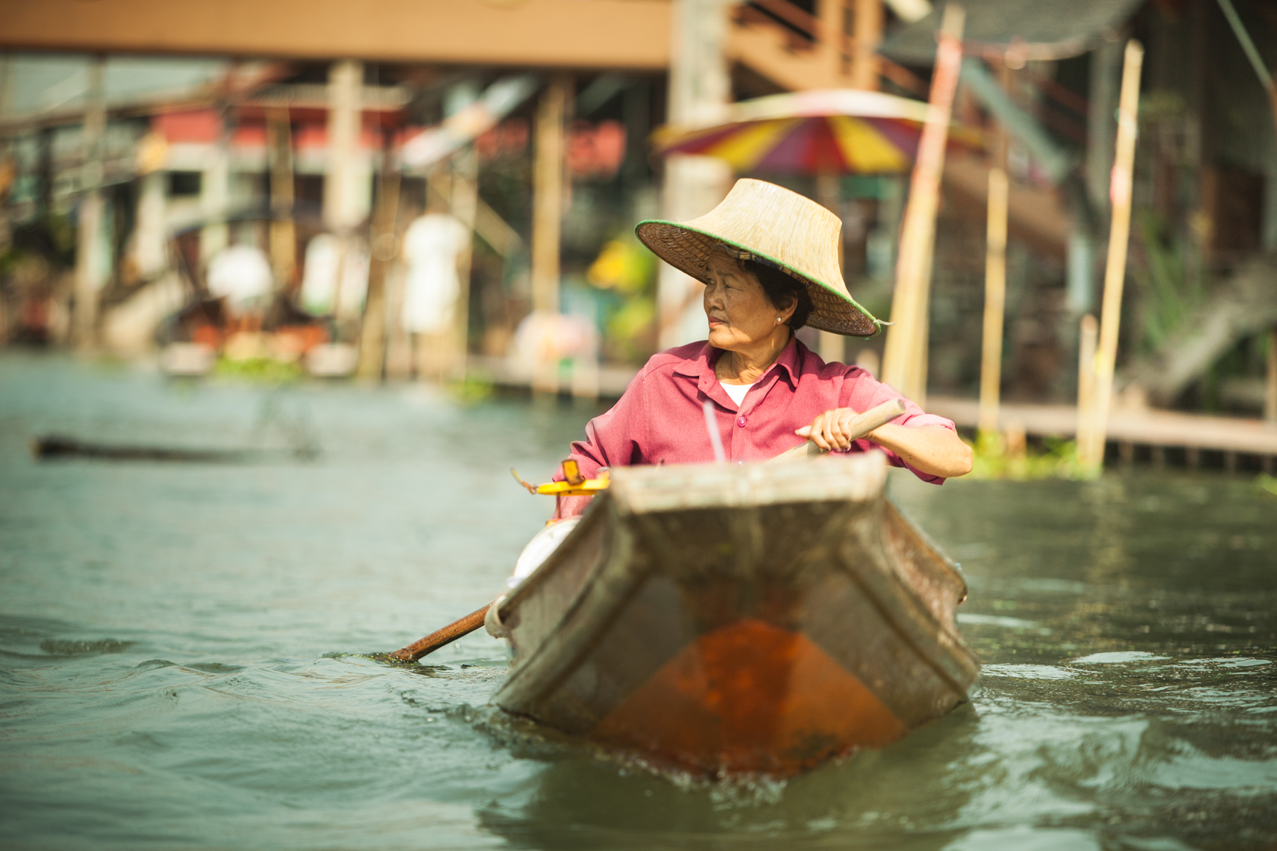 Woman Boating Down River in Thailand