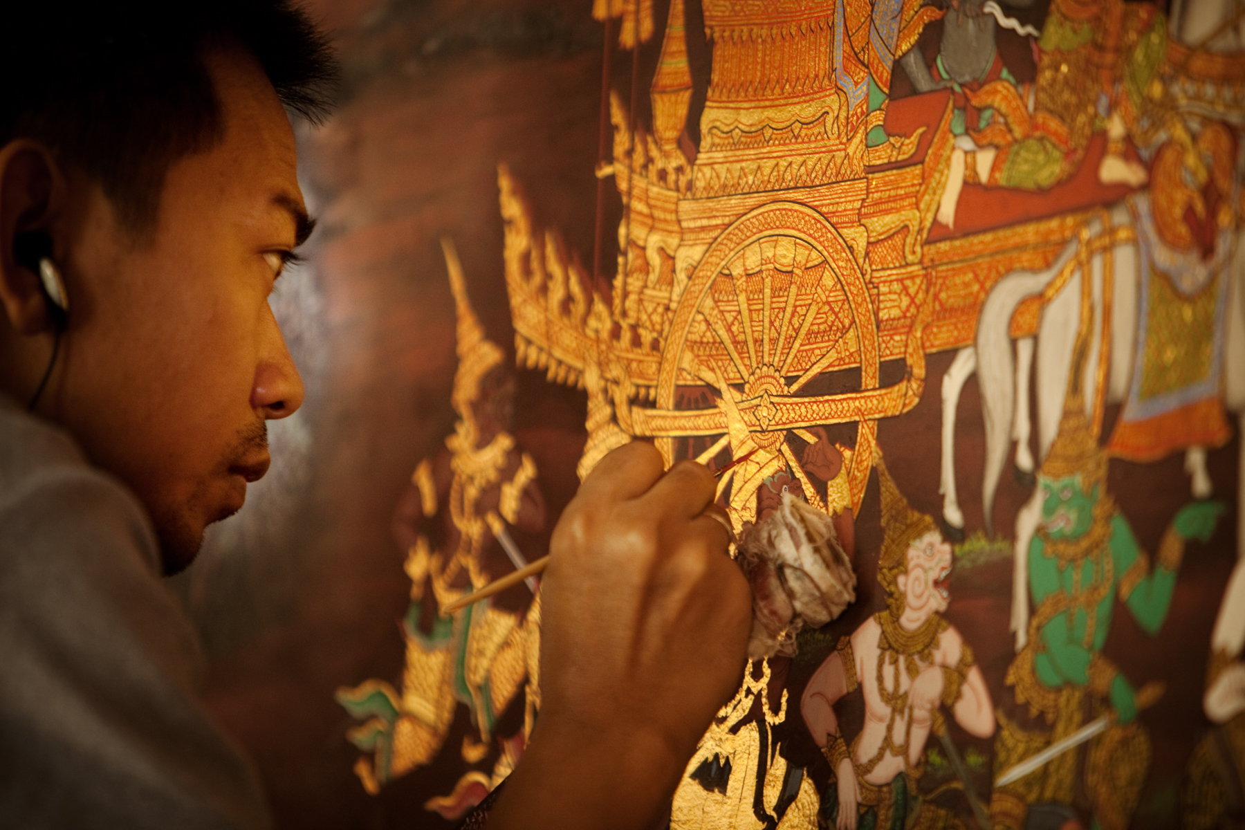 Artist Painting on a Wall in a Temple in Thaiand